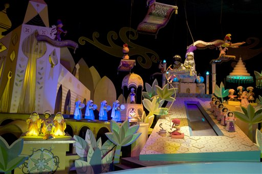 """This Jan. 23, 2009 file photo shows the characters Aladdin, Jasmine and Abu from the film, """"Aladdin,"""" on the """"It's A Small World"""" ride, at Disneyland in Anaheim, Calif. An attorney says a disabled man, Jose Martinez, was awarded $8,000 by Disneyland after the """"It's A Small World"""" ride broke in 2009, stranding him for half an hour while the theme song played continuously.  (AP Photo/Damian Dovarganes, File)"""
