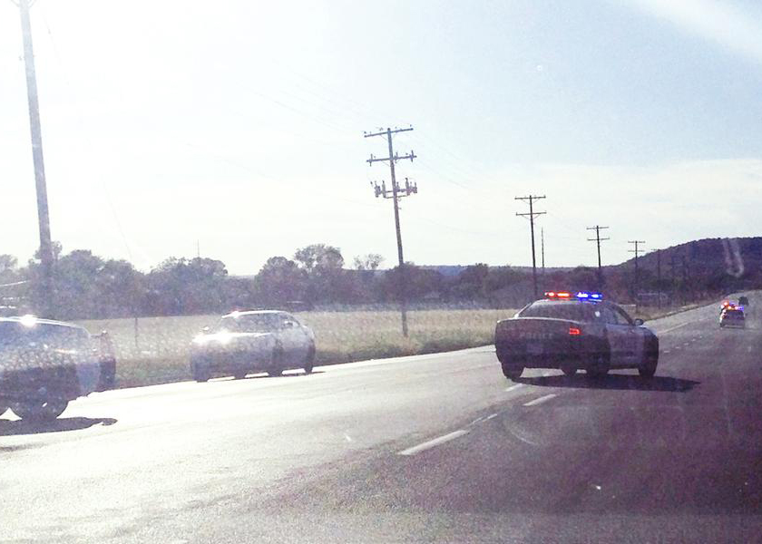 """After stopping on S.E. Martin Luther King Jr. Street, a motorist took this photograph, through the windshield, of Tuesday evening's high-speed chase. The pursuit ended shortly afterwards, when police arrested the driver, Justin P. Simmons, 24. This photographer said the driver took this turn so fast his truck was riding on """"two wheels"""" as it passed by. (Photo courtesy of Mineral Wells Index)"""