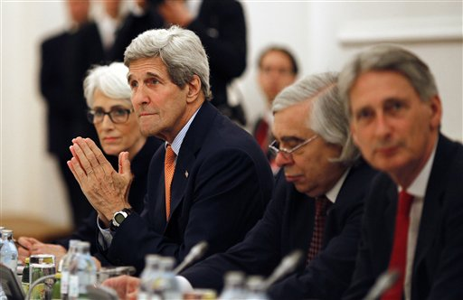 U.S. Secretary of State John Kerry meets with foreign ministers of Germany, France, China, Britain, Russia and the European Union at a hotel in Vienna, Austria, Tuesday, July 7, 2015. Iran nuclear talks were in danger of busting through their second deadline in a week Tuesday, raising questions about the ability of world powers to cut off all Iranian pathways to a bomb through diplomacy, and testing the resolve of U.S. negotiators to walk away from the negotiation as they've threatened.(Carlos Barria/Pool photo via AP)