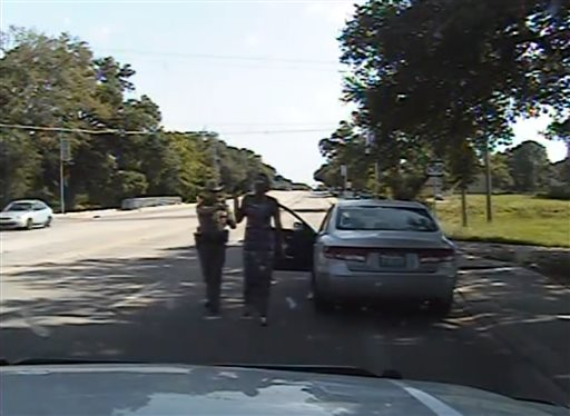 In this July 10, 2015, frame from dashcam video provided by the Texas Department of Public Safety, trooper Brian Encinia arrests Sandra Bland after she became combative during a routine traffic stop in Waller County, Texas. Bland was taken to the Waller County Jail that day and was found dead in her cell on July 13. (Texas Department of Public Safety via AP)