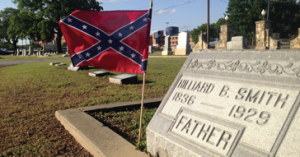 "Managing Editor Denise Harroff placed third in the ""news photo"" category for her photo of the Confederate flags that are placed in the cemetery across campus every year."