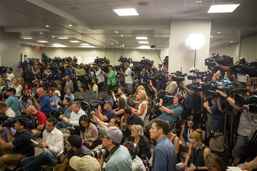 Media members pack the room as nine trauma surgeons and survivor Angel Colon speak for the first time about the aftermath of the mass shooting that killed dozens and hospitalized many more at an Orlando gay nightclub, during a press conference at the Orlando Regional Medical Center in Orlando, Fla., on Tuesday, June 14, 2016.  Photo by Loren Elliott/Tampa Bay Times via AP.