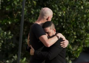 Mourners embrace outside the visitation for Pulse nightclub shooting victim Javier Jorge-Reyes on Wednesday, June 15, 2016, in Orlando, Fla. (AP Photo/David Goldman)