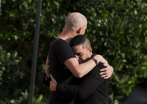 Mourners embrace outside the visitation for Pulse nightclub shooting victim Javier Jorge-Reyes on Wednesday, June 15, 2016, in Orlando, Fla. (AP Photo/David Goldman)