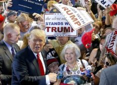 Republican presidential candidate Donald Trump, left, shouts to Secret Service agents that supporter Diana Brest, right, had been waiting in line since 2 a.m. to see the candidate speak at a rally Saturday, June 18, 2016, in Phoenix. (AP Photo/Ross D. Franklin)