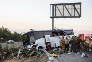 Rescue crews work at the scene of a charter bus crash on northbound Highway 99 between Atwater and Livingston, Calif., Tuesday, Aug. 2, 2016. A charter bus veered off a central California freeway before dawn Tuesday and struck a pole that sliced the vehicle nearly in half. Photo by: Andrew Kuhn Merced Sun-Star.