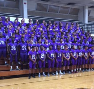 Texan football players pose for a team photo at media day in Wisdom Gym.  Photo by TR Varnado.