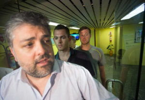 Accompanied by Brazilian lawyer Sergio Riera, left, American Olympic swimmers Gunnar Bentz, center left, and Jack Conger, right, leave the police station at Rio International airport early Thursday Aug. 18, 2016. The two were taken off their flight from Brazil to the U.S. on Wednesday by local authorities amid an investigation into a reported robbery targeting Ryan Lochte and his teammates. According to their lawyer they will not be allowed to leave Brazil until they provide testimony about the robbery. Photo by AP Mauro Pimentel, Associated Press.