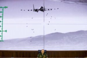 Lt.-Gen. Sergei Rudskoi of the Russian Military General Staff speaks to the media, as a video released by the Russian Defense Ministry shows a Russian warplane unloads its weapons over target on screen at a Russian Defense Ministry building in Moscow, Russia, Wednesday, Aug. 10, 2016. Rudskoi said that fighting in Aleppo will cease for three hours daily to allow humanitarian aid deliveries. Photo by Ivan Sekretarev.