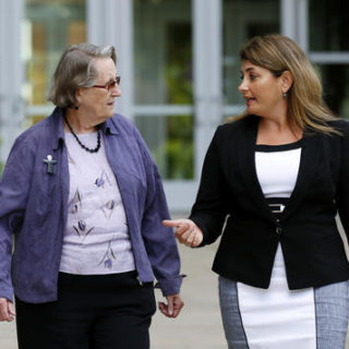 In this Aug. 11, 2016 photo, Angela McArthur, right, director of the Anatomy Bequest Program at the University of Minnesota Medical School, walks with Jean Larson, widow of a donor in Minneapolis. Once a relatively rare option, body donation has surged at medical schools, including the University of Minnesota. The increase has helped provide cadavers for dissection by first-year medical students, and for research and surgical training. Photo by Andy Clayton-King, Associated Press.