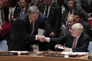 Petro Poroshenko, President of Ukraine, left, greets British Foreign Secretary Boris Johnson during a Security Council meeting, Wednesday, Sept. 21, 2016, at U.N. headquarters.  Photo by Julie Jacobson, Associated Press.