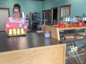 Sweetenville owner Jessica Curry displays some of her creations. Photo by Arynn Tomson, Texan News.