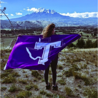 Adriana Rivas won't first place for her photo of herself holding the Tarleton flag in front of the Chimborazo Mountain in Ecuador.  Photo Courtesy of Adriana Rivas.