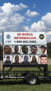 Wanted posters at a border checkpoint. Photo by Jace Fry